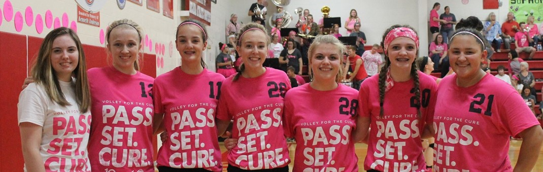 JV Volleyball players displaying the Volley for the Cure Shirts