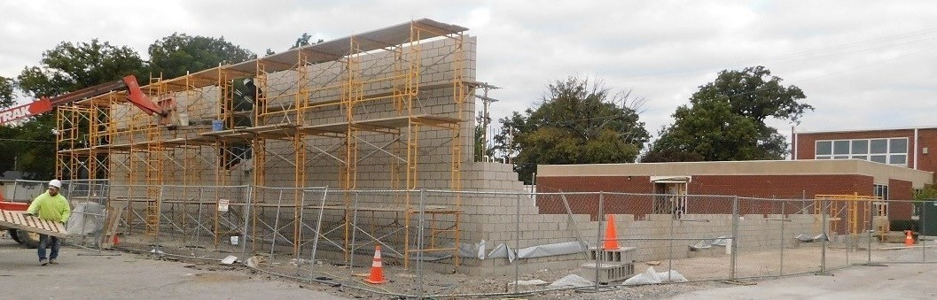 Picture of scaffolding and the south wall of the classroom construction project